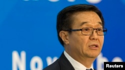 FILE - A former JPMorgan executive alleged that Chinese Commerce Minister Gao Hucheng, shown at a news conference in Beijing in November, sought favorable treatment for his son from the company.