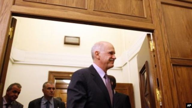 Greece's Prime Minister George Papandreou after a Cabinet meeting at the parliament in Athens, November 6, 2011.