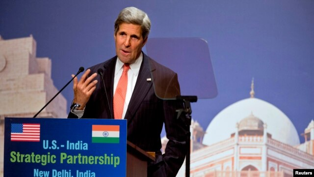 U.S. Secretary of State John Kerry speaks about climate change at the India Habitat Center in New Delhi, June 23, 2013.