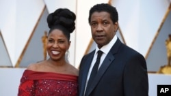 Pauletta Washington, left, and Denzel Washington arrive at the Oscars, Feb. 26, 2017, at the Dolby Theatre in Los Angeles.