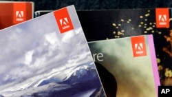 Adobe software displayed at a store in Hialeah, Florida, June 21, 2017. A new service aims to help marketers follow you around by linking discrete activities online, such as visiting Subway's website on a computer and checking the NFL's app on a phone.