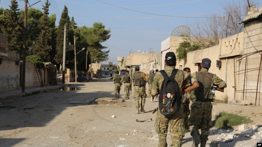 Turkish troops are entering Rass al-Ain, a Kurdish-held town in Syria.  October 12, 2019
