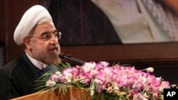 In this photo released by the official website of the office of Iranian President-elect Hasan Rouhani, Rouhani speaks in a conference in Tehran, June 29, 2013.