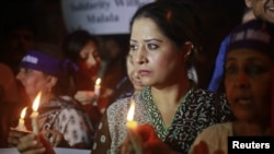 Women hold candles during a rally condemning the attack on schoolgirl Malala Yousufzai, Karachi, Pakistan, October 11, 2012.