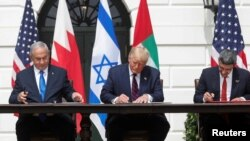 Israel's Prime Minister Benjamin Netanyahu, U.S. President Donald Trump and United Arab Emirates Foreign Minister Abdullah bin Zayed sign the Abraham Accords, normalizing relations. (Sept. 15)