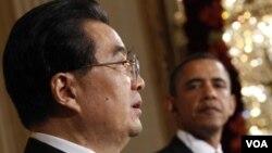 El presidente Barack Obama con el mandatario chino, Hu JIntao, en Washington.