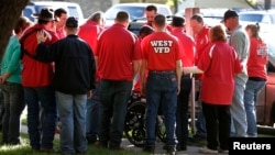 Members of the West Volunteer Fire Department gather after attending a service at St. Mary's Church of the Assumption, two days after an explosion at a fertilizer plant in West, Texas, April 19, 2013.