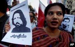 A woman holds a portrait of missing university professor and poet Salman Haider during a rally in support of Haider and other activists, in Karachi, Pakistan, Jan. 10, 2017.