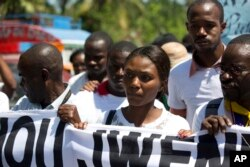 Fleurette Guerrier, the wife of missing photojournalist Vladjimir Legagneur, joins hundreds of journalists in a march to demand an investigation into why the freelance photographer vanished while on assignment, in Port-au-Prince, Haiti, March 28, 2018.