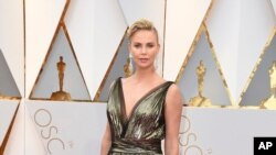 Charlize Theron arrives at the Oscars on Sunday, Feb. 26, 2017, at the Dolby Theatre in Los Angeles.