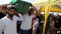 People carry a victim's coffin as they attend funeral services for dozens of people killed in last night's bomb attack targeting an outdoor wedding party in Gaziantep, southeastern Turkey, Aug. 21, 2016.