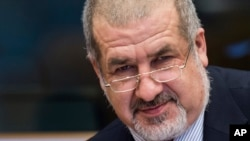 Crimean Tatar community leader Refat Chubarov arrives for a Security and Defense Committee meeting at the European Parliament in Brussels on Tuesday, March 24, 2015. The committee exchanged views on the militarization of Crimea and the security situation one year after the annexation by Russia. (AP Photo/Geert Vanden Wijngaert)