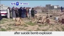 VOA60 World PM - Suicide Bombers Strike Wedding in Iraq, Kill at Least 26