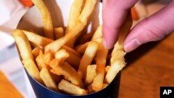 FILE - Fast food French fries.
