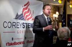 """FILE - Republican candidate for governor of Virginia, Corey Stewart, speaks at a campaign kickoff rally in a restaurant in Occoquan, Va., Jan. 23, 2017. Stewart, a tough-talking former Donald Trump campaign chairman, says the president's victory has freed candidates to """"simply be yourself."""""""