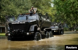 Houston police vehicles move through Harvey floodwaters in Houston, Texas, Sept. 1, 2017.