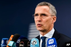 FILE - NATO Secretary-General Jens Stoltenberg talks with journalists as he arrives for a meeting of EU foreign and defense ministers at the Europa building in Brussels, May 18, 2017.