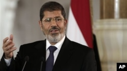 Egyptian President Mohammed Morsi, in Cairo, Friday, July 13.