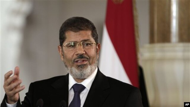 Egyptian President Mohammed Morsi speaks to reporters after meeting Tunisian President Moncef Marzouki in Cairo, Friday, July 13.