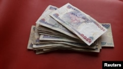FILE - Nigerian naira notes are seen in this picture illustration March 15, 2016.
