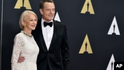 "Helen Mirren, left, and Bryan Cranston star in the new movie ""Trumbo."""