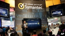 FILE - In this April 22, 2015 file photo, a presentation is made in the Symantec booth during the RSA Conference in San Francisco.