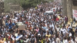 Syrians at a funeral in Daraa on Friday carry the body of a man who protesters say was killed by forces loyal to Syria's President Bashar al-Assad