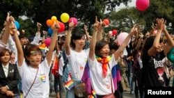 "Participants take part in a flash mob during a lesbian, gay, bisexual, and transgender (LGBT) event on a street in Hanoi, Oct. 27, 2013. In 2013, ""a lively public debate about lesbian, gay, bisexual, and transgender rights took place"" throughout Vietnam."