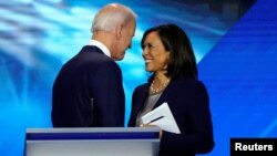 FILE - Former Vice President Joe Biden talks with Senator Kamala Harris after the conclusion of the 2020 Democratic U.S. presidential debate in Houston, Texas, U.S., September 12, 2019. (REUTERS/Mike Blake/File Photo)