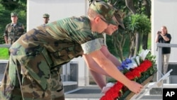 Marines Andrew Cardwell of Cincinnati, Ohio, left, and Sarah Robbins of Denver, Colo., lay a wreath at the National Memorial Cemetery of the Pacific in Honolulu, Dec. 6, 2012.