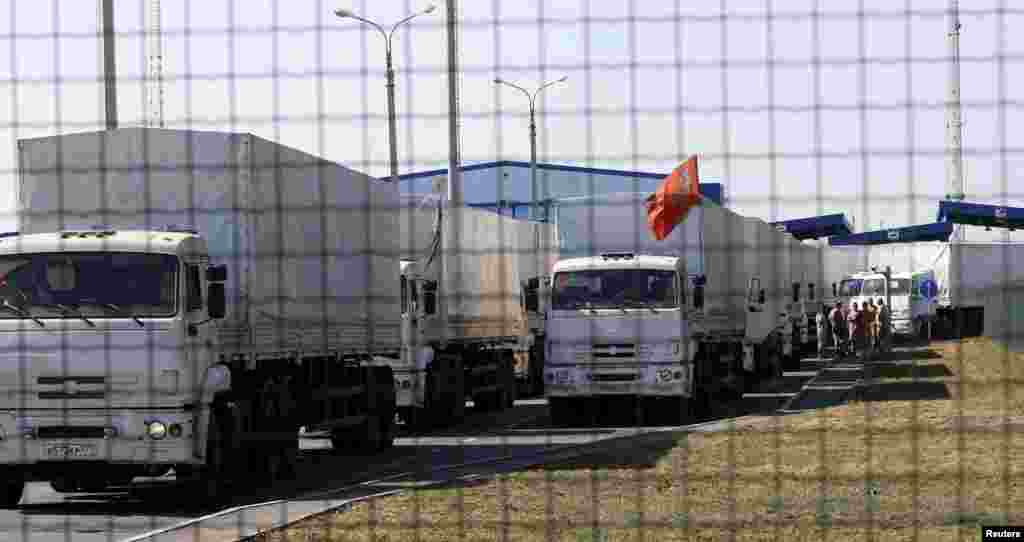 "Trucks from a convoy that delivered humanitarian aid for Ukraine are seen inside border crossing point ""Donetsk"" in Russia's Rostov Region as they move back to Russia, Aug. 23, 2014."
