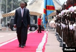 Angola's President Joao Lourenco inspects a guard of honor before meeting Democratic Republic of Congo's President Joseph Kabila in Kinshasa, Democratic Republic of Congo, Feb. 14, 2018.