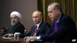 Erdogan, Putin i Rohani (s desna) na konferenciji za novinare u Sočiju, u novembru prošle godine (Mikhail Klimentyev/Pool Photo via AP)
