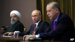 Turkey's President Recep Tayyip Erdogan, right, Russia's President Vladimir Putin, center, and Iran's President Hassan Rouhani are seen at a news conference in Russia's Black Sea resort of Sochi, Russia, Nov. 22, 2017. The three are due to meet Wednesday