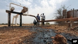 Oil well oozes crude it was hit by bomb shrapnel from fighter jets at El Nar oil field in South Sudan's Unity State, March 3, 2012.