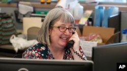 LibrarianHolly Ryckman smiles as she chats with 81-year-old Dell Kaplan from the Davis Library in Plano, Texas Friday, May 15, 2020. (AP Photo/LM Otero)