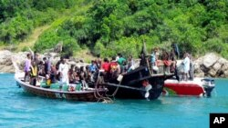 A boat carrying 73 Rohingya refugees is intercepted by Thai authorities off the sea in Phuket, southern Thailand, January 1, 2013.