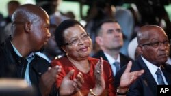 From Left: Mandla Mandela, grandson of former president Nelson Mandela, Graca Machel, wife of Mandela, and president Jacob Zuma attend the opening of the revamped Nelson Mandela Centre of Memory in Johannesburg, Nov. 18, 2013.