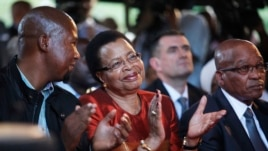 From Left: Mandla Mandela, grandson of former president Nelson Mandela, Graca Machel, wife of Mandela, and president Jacob Zuma attend the opening of the revamped Nelson Mandela Centre of Memory in Johannesburg, Nov. 18, 2013.