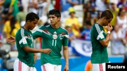 File - Alan Pulido (center) in the 2014 World Cup.