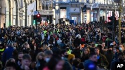 Crowds of shoppers walk under the Christmas lights in Regent Street, in London, Saturday, Dec. 12, 2020. Health Secretary Matt Hancock says infections are starting to rise in some areas after falling during a four-week national lockdown in England…