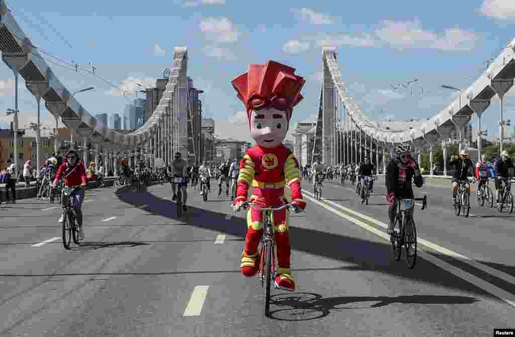 A cyclist wearing a costume of a cartoon character rides during the Cycling Festival in Moscow, Russia.