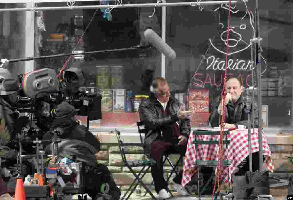 "Actors Tony Sirico, who plays Paulie Walnuts and James Gandolfini, who plays Tony Soprano, shoot a scene from the mafia drama, ""The Sopranos,"" outside the fictional Satriale's pork store in Kearny, New Jersey, March 21, 2007."