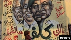 Mural depicts combination of the faces of former Egyptian president Mubarak and Field Marshal Tantawi, Cairo, June 14, 2012.