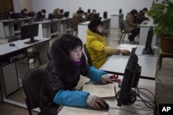 FILE - North Koreans work at computer terminals inside the Grand People's Study House in Pyongyang, North Korea, January 9, 2013.