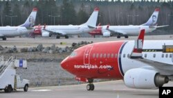 FILE - Boeing 737-800 aircraft belonging to budget carrier Norwegian are parked at Stockholm Arlanda Airport, March 5, 2015.