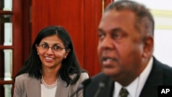 Sri Lanka's Foreign Minister Mangala Samaraweera, right, speaks as U.S. Assistant Secretary of State for South and Central Asian Affairs Nisha Biswal smiles during a media briefing in Colombo, Sri Lanka, Monday, Feb. 2, 2015.