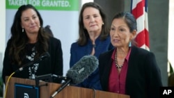 Interior Secretary Deb Haaland responds to a question as Becky Mitchell, left, of the Colorado Water Conservation Board, and U.S. Rep Diana DeGette, D-Colo., look on during a news conference, in Denver, July 22, 2021.