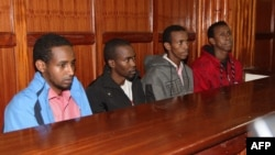 FILE - This picture taken on Nov. 14, 2013 shows (from L) four men charged in connection with the Westgate mall massacre, Mohamed Abdi Ahmed, Omar Liban Abdulle, Adan Mohamed Ibrahim, and Hussein Hassan Mustafa sitting at court in Nairobi.