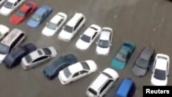 A still image taken from video shows submersed cars in floods water after Hurricane Maria battered Caguas, Puerto Rico, Sept. 20, 2017.